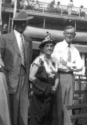 Pictured L-R:'Mr. Pick Russell,II', my grandfather Russell; 'Miss Kitty Russell', my grandmother Russell; and son Sanders Russell pictured aboard an excursion boat on a rare trip to the races at Roosevelt Raceway in the 1940s or early 1950s.